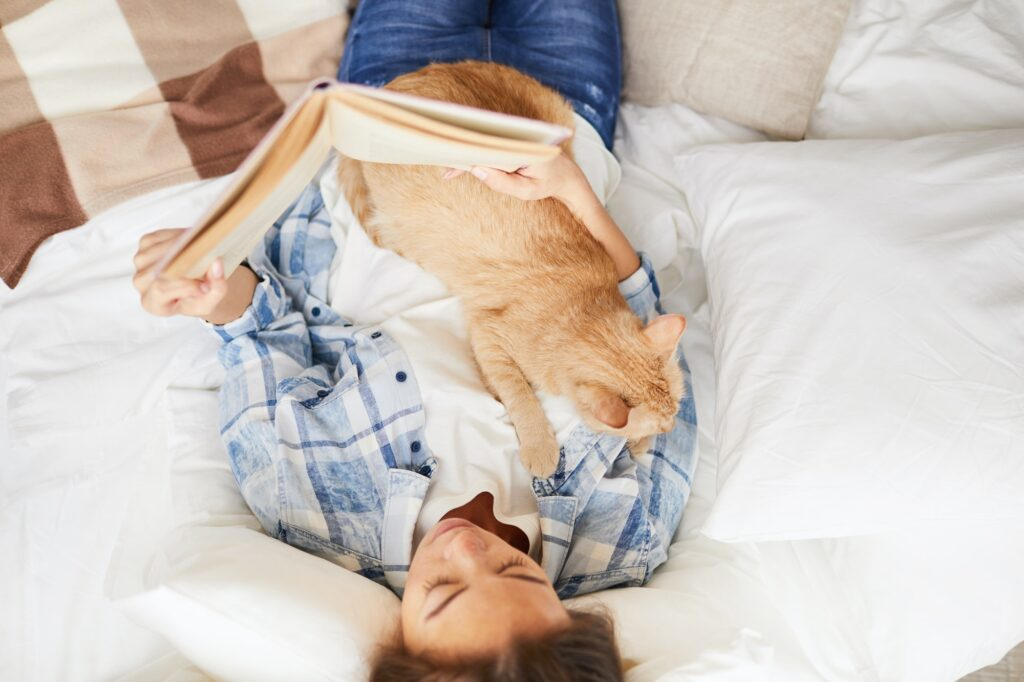 Woman Reading Book with Cat
